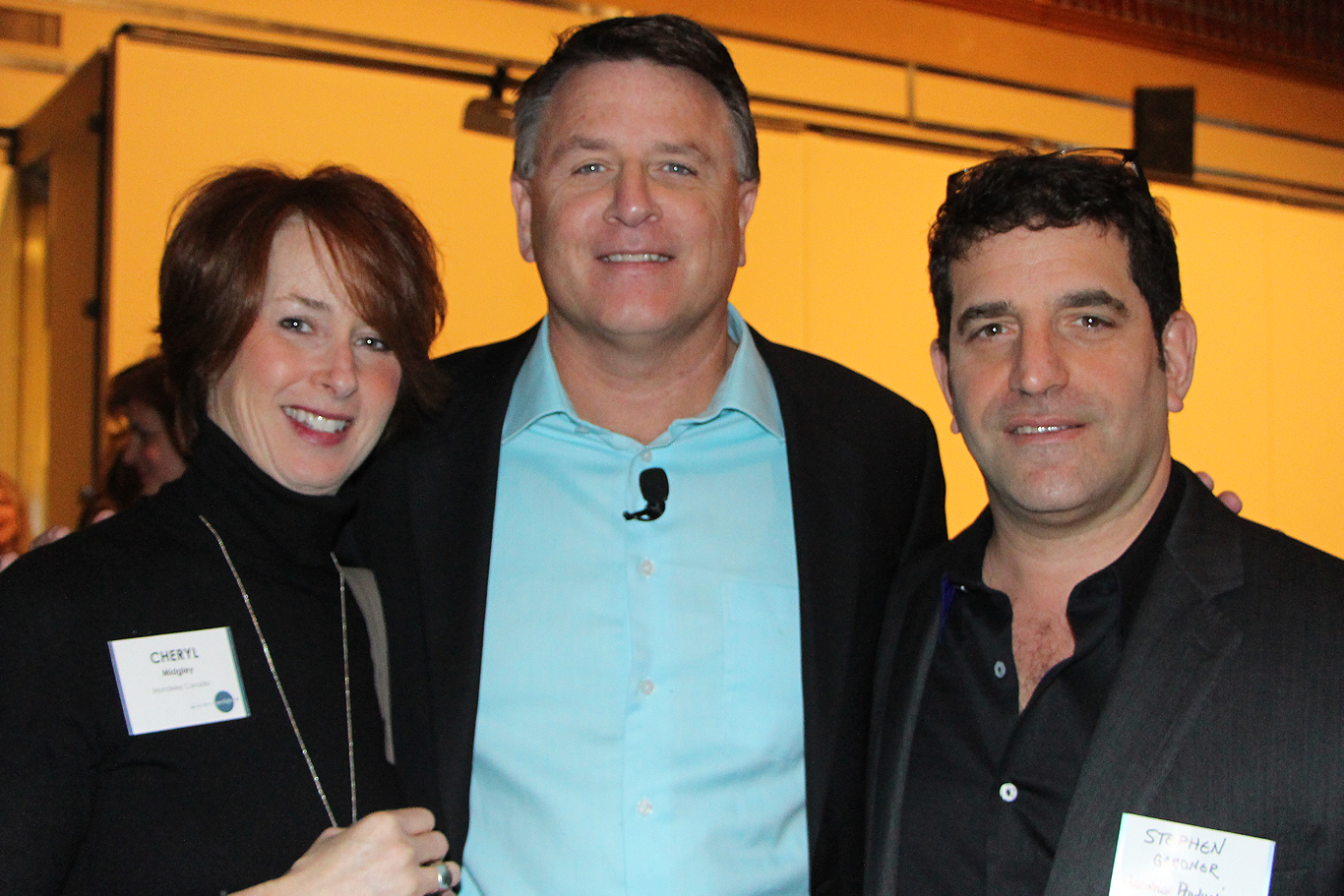 Steve Gardner (right), with speaker David Chilton and Cheryl Midgley of Mondelez Canada