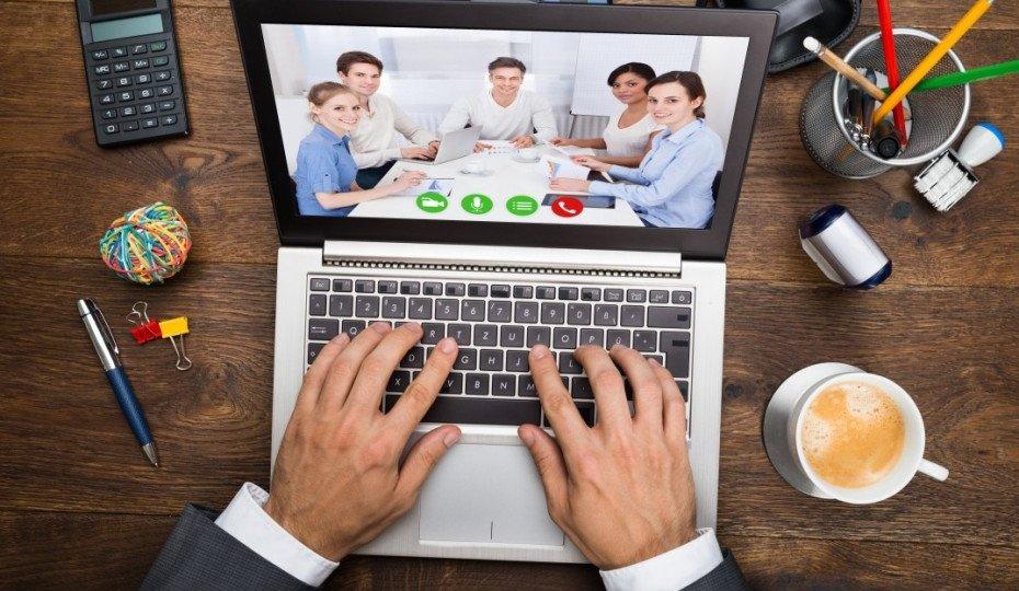 bigstock-Businessman-In-Video-Conferen-930x621