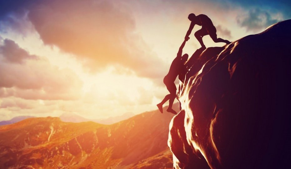 bigstock-Hikers-climbing-on-rock-mount-930x698