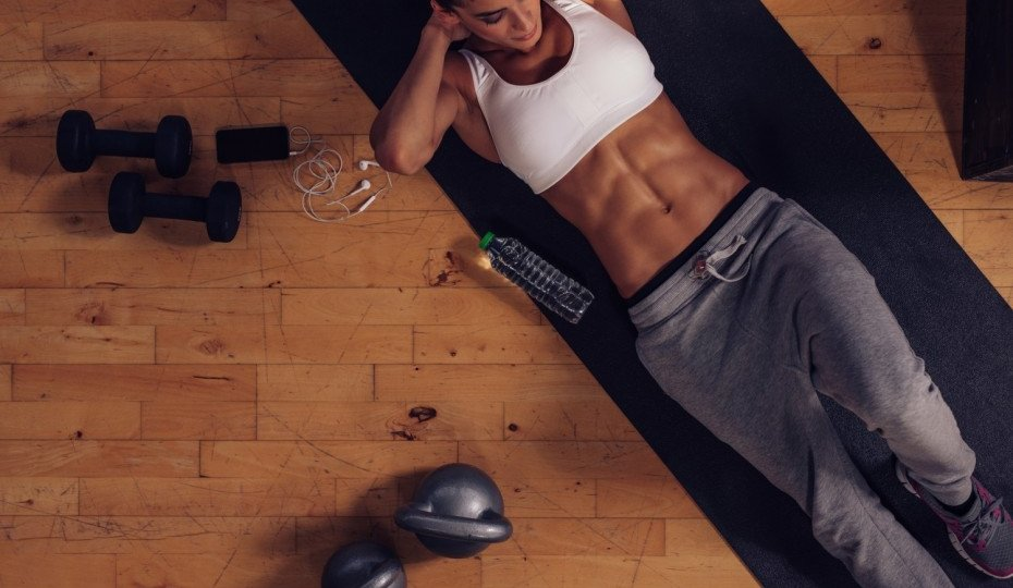 bigstock-Muscular-Woman-Doing-Abs-Worko--930x620