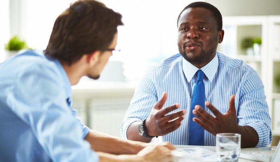 bigstock-Two-managers-having-conversati-930x620