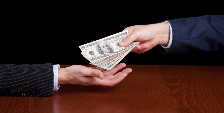 bigstock-businessman-giving-money-15473822-1073x715
